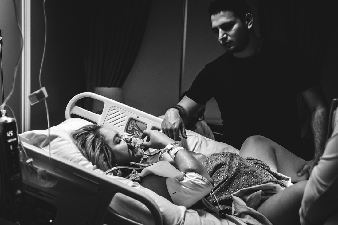 black and white photo of mom receiving oxygen while pushing during birth lowcountry sc birth photography