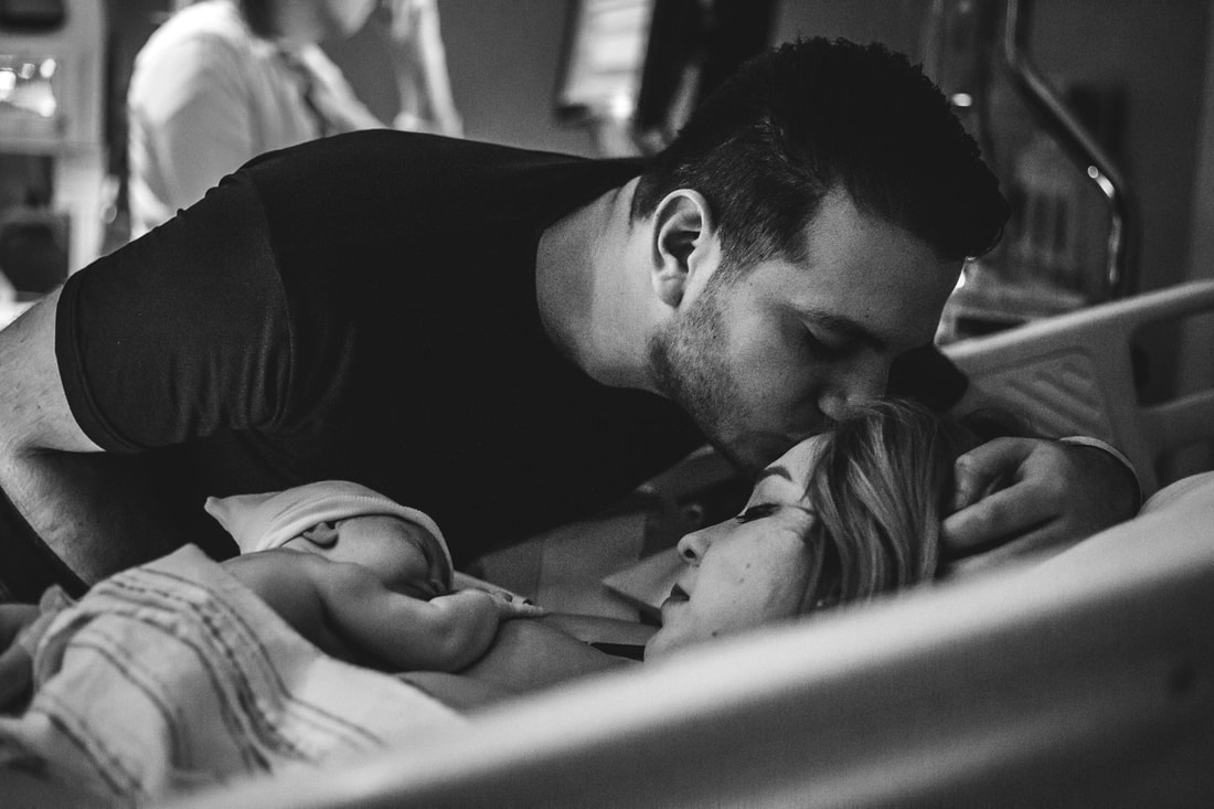 Black and white photo of new family after birth charleston sc birth photographer