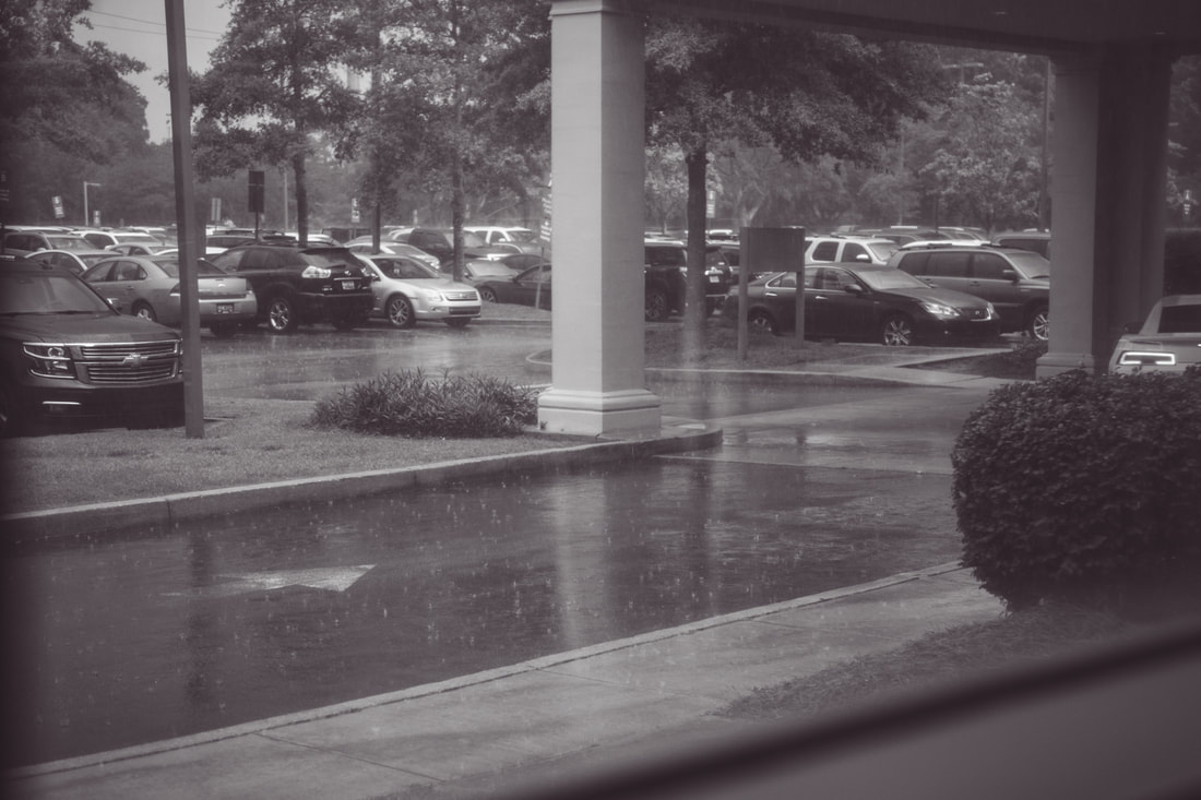 black and white photo of rain outside a hospital during a charleston, sc birth story
